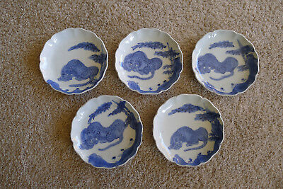 Rare old set of five Japanese Edo period blue and white Imari plates with tigers