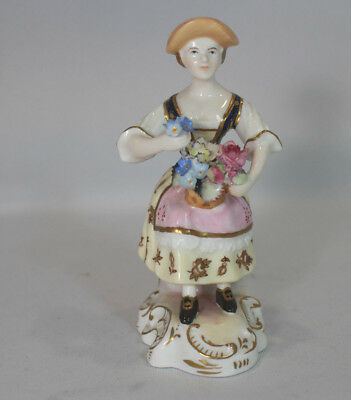 Royal Crown Derby Figurine called the Flower Seller