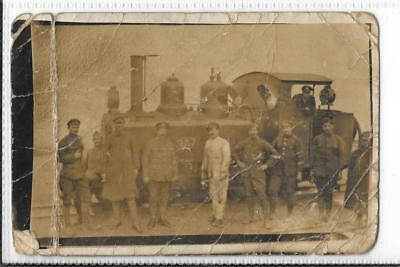 WW1 Photographic Postcard Soldier by Railway Engine
