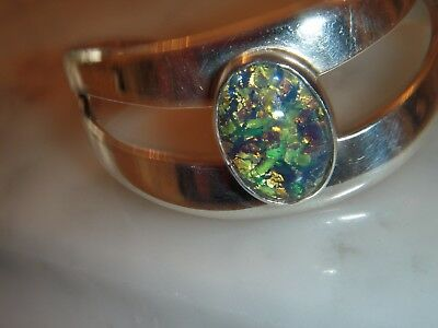 A Beautiful Art Deco Design Solid Silver 10.00 Carat Oval Opal Torc Bangle