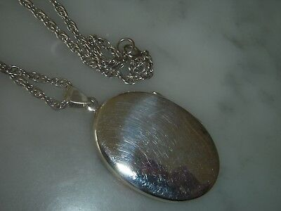 A Beautiful Large Silver Oval Back And Front Locket And Chain
