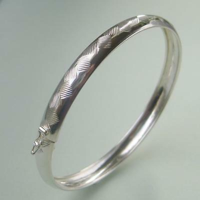 Sterling silver bangle with textured surface.