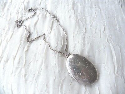 Large solid silver engraved oval locket on a silver chain