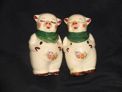 "Shawnee Pottery Smiley Pig 5"" Salt and Pepper Shakers with gold trim and decals"