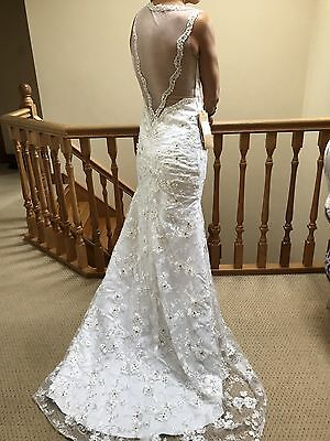 Brand new White Backless (see Through)Wedding Dress With Veil And Under Skirt