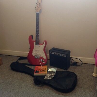 Red Electric Guitar Amplifier & Automatic Tuner with carrier bag& guitar book