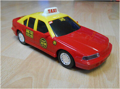 Juguetes Truquito (Argentina) Plastic Friction BMW Taxi yellow/red