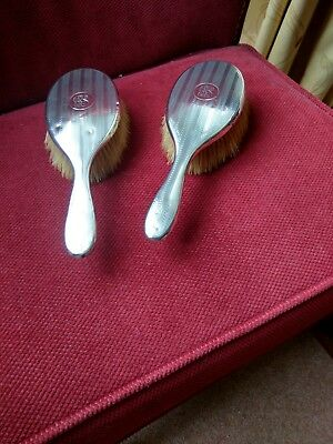 Matching pair of hallmarked silver  hairbrushes in very good condition