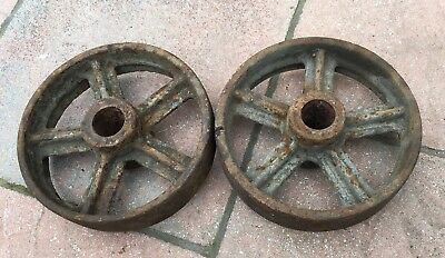A Pair Of Cast Iron Wheels