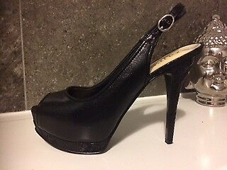Fabulous high black shoes by Guess size 4.5 Unworn.