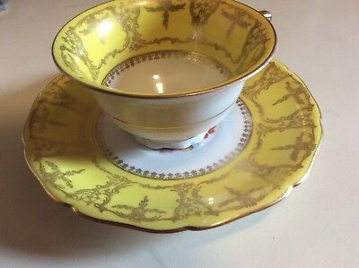 Baronet Czechoslovakia Made In Bohemia Yellow Cup & Saucer With Floral Interior