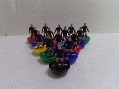 Subbuteo Rugby Team Ref 5 New Zealand All Blacks On Different Colour Bases.