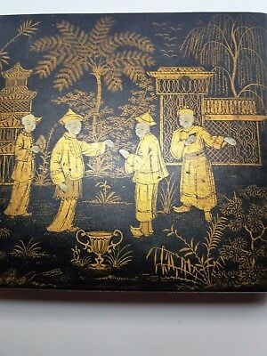 Antique Japanese lacquered box with ornate garden scene