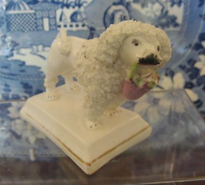 Large Staffordshire Judge Poodle Figure with Basket of Flowers, Circa 1840