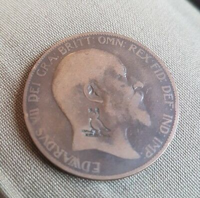 Defaced 1905 Edward VII Penny with what looks like an Owl on Skis