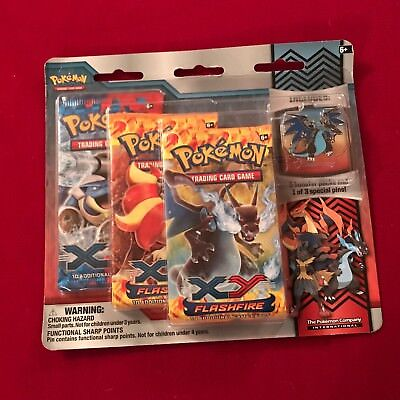 Pokemon Flashfire Booster 3 Pack Sealed plus collectors badge