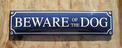 ENAMEL 'BEWARE OF THE DOG' SIGN. WHITE TEXT ON A BLUE BACKGROUND. 33x8cm.