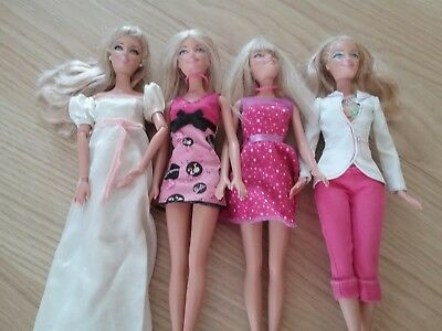 Collection of barbie dolls including an articulated  barbie with jointed body...