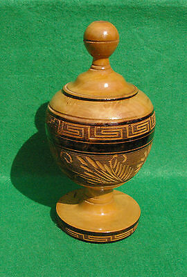 A  Decorately Turned And Carved Wooden Pot With Lid