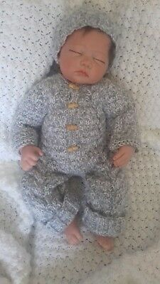 0-3months Hand knitted all in one coat and hat in grey and  white.