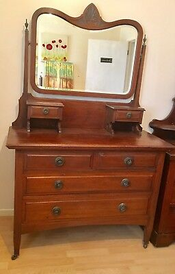 Antique mahogany chest of drawers with mirror