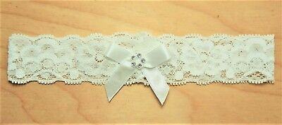 Baby Girls Ivory Stretch Lace Headband With Satin Diamante Bow