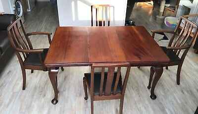 Antique solid mahogany Queen Anne style extending dining table and four chairs