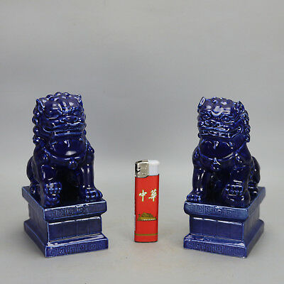 A pair China old hand-carved porcelain blue glaze money drawing lion statue