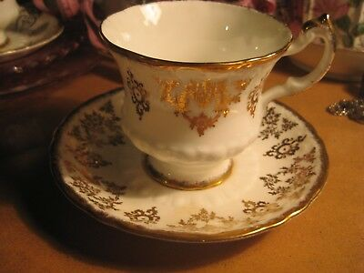 Vintage Paragon Fine Bone china England Gold White Teacup And Saucer