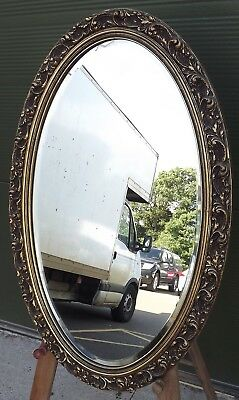 Lovely Decorative Gilt-Framed Oval Bevel-Edged Wall Mirror In The Antique Style