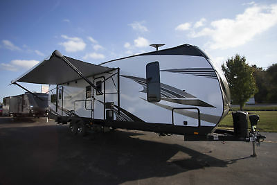 Go Home for the Holidays in a NEW 2018 Torque XLT T322 Travel Trailer Toy Hauler