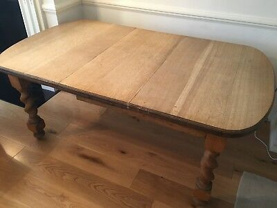 Victorian extendable oak dining table with barley twist legs - seats 8