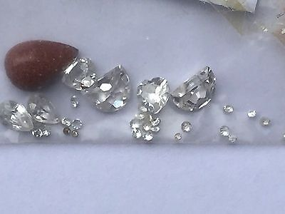 Collection of cubic zirconia of varied sizes and shapes and a yellow VENTURINA