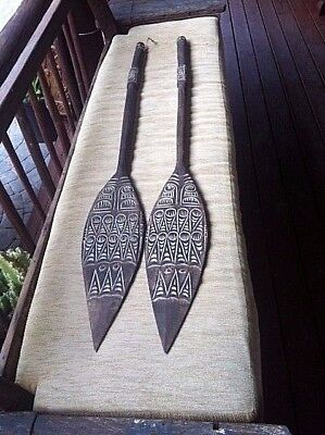 2 decorative wood paddle oars from Indonesia