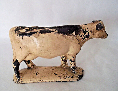 Antique cow primitive folk art painted metal marked made in U.S.A.vintage animal