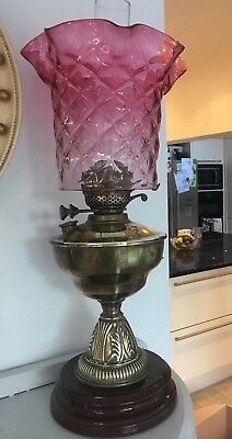 large victorian brass oil lamp with large cushion ruffle cranberry lampshade