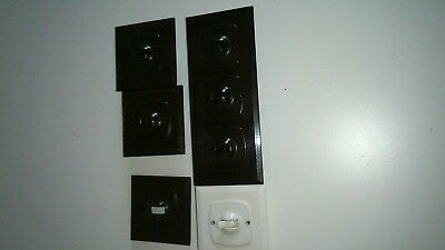 Vintage Britmac toggle light switches with face plates.