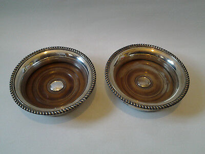 antique pair of silver plated bottle coasters with wooden bases vintage