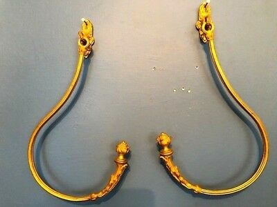 pair of gold gilded brass french curtain tiebacks mid to late 1800s era side ang