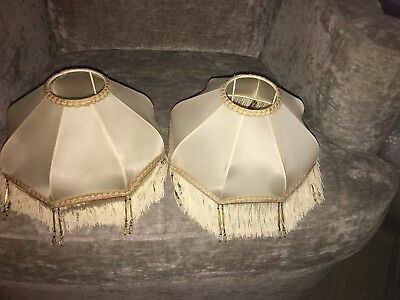 pair of small cream lampshades with fringes and beads