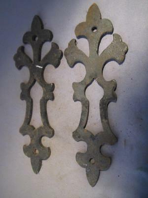Pair of cast iron escutcheons