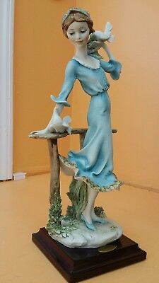 "G.Armani florence porcelain figurine ""Girl with dovs """