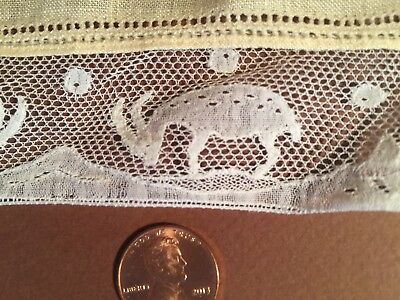 Vintage handkerchief edged with quaint lace with mountain goats design