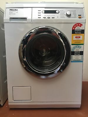 Miele washer W5835 WPS and Miele dryer T8827 WP with Miele stacking kit WTV412