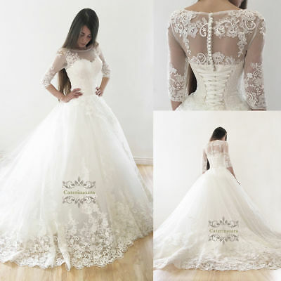 Bridal Ball gown wedding dress with a beaty french lace long tail buttons back