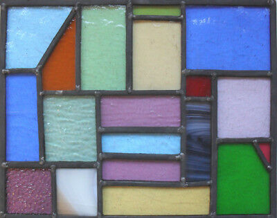 stained glass panel with a variety of differing types of Glass .