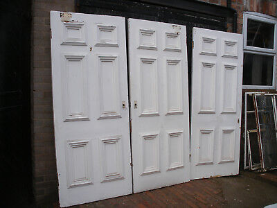Reclaimed very large and heavy Georgian six panel doors.