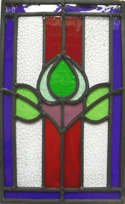 stained glass panel in traditional floral motif .