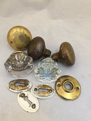 mixed lot of antique salvage glass and brass doorknobs escutcheon plates rosette