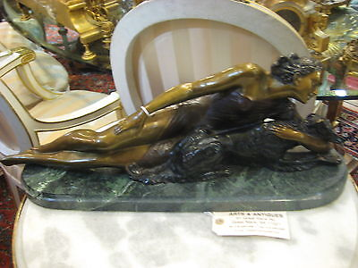 Bronze Statue of a Woman Resting with Her Dog on a Green Marble Stand